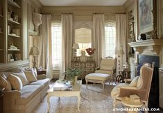 In the sitting room, the owners' collections are displayed alongside strong, architectural pieces and sculptural mirrors for added interest. A hand-painted Italian chest from Bonnie Blackmon Antiques holds court between the windows.