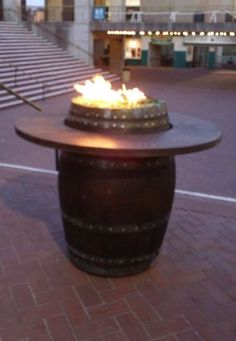 Wine Barrel Fire Pit or just a neat bar with the top of barrel showing instead of being the top of bar with glass or something