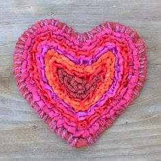 Hooked Heart with Color Crazy hand-dyed fabric strips. Edges wrapped in burgundy jute twine. It's a locker hooked coaster! colorcrazy.com - t. pulido