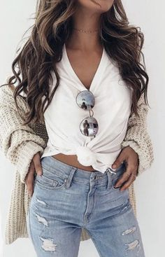 White Vneck Shirt, Light Wash Ripped Jeans, Cream Cardigan.