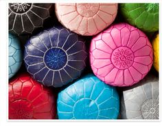Moroccan leather footstools from Bohemia - like the colours!
