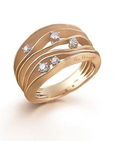 Collezione Dune: anello in oro arancio con brillanti