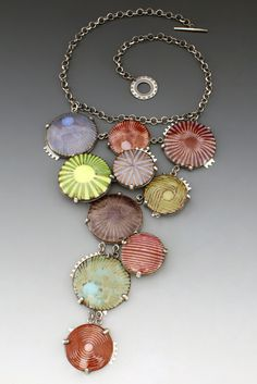 L. Sue Szabo -On the Boardwalk Enamel on copper, sterling silver. Champleve enamel, photoetched, hand fabricated, prong set.