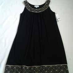 Elegant  simple dress  (NWT) W/gold trims top n bottom around.  poly95%, spandex 5%,handwash cold, cool iron, dry flat, 1 lb. weight,  apprx. 29 inches long , fr. below armpit down., covers knee, sleeveless. Ronni Nicole Dresses