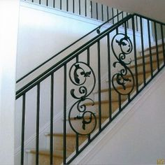 staircase-elegant-black-wrought-iron-stair-railing-with-simple-line-shaped-handrails-space-also-flat-style-baluster-that-have-flower-pattern-decorating-wrought-iron-stair-railing-design-ideas-for-insp-300x300.jpg 300×300 pixels
