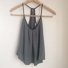 [Kimchi Blue] Silk Racerback Top Re-posh... Loved this but it is unfortunately too small for me. Definitely true to XS size (bought in the hopes it would fit a small but didn't). 100% silk. Urban Outfitters Tops Tank Tops