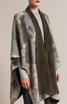 $1,055.00   Avant Toi Jacquard Poncho in Corda   Avant Toi clothing, by Mirko Ghignone, is avant garde and elegant. It is created by using experimental hand-dyeing and processing on fine fabrics and textiles. The line crosses into elegant and artistic with a grungy aesthetic. This grey cashmere & wool poncho is simple yet textural in color. Avant Toi is sold online and in-store at Santa Fe Dry Goods & Workshop in Santa Fe, New Mexico.