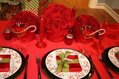 Red napkins folded into a small square and wrapped in ribbon to look like a present.