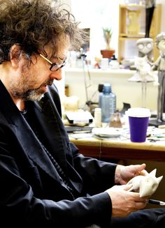 "Director Tim Burton on the set of 2012's Frankenweenie, holding his star, ""Sparky""."