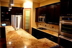 Kitchen Remodeling and Design ideas.  Granite Countertops, Custom Cabinets and Travertine Backsplash.