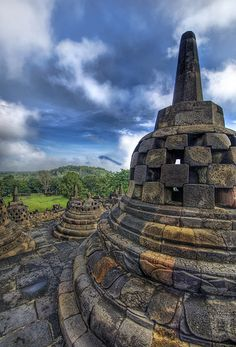 Buddah's Steeple (with a volcano poking through the fog), Borobudur, Indonesia