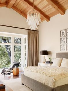 What I wouldn't give to have lovely, tall windows like that in my bedroom.