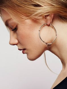 Feel The Rhythm Hoop Set | Set of 2 different sized statement hoops. Mix-n-match or wear as a pair.    * Mixed metal detailing.   * Hinge hoop closure.