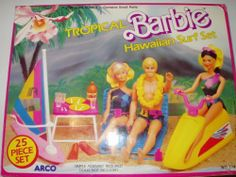 1986 Vintage Tropical Barbie: Hawaiian Surf Set by Arco. $87.99. Contents: Jet Ski, sail, 2 lounge chairs, surfboard, Walkman, headphone, coffee table, orange drink, 4 glasses 2 plates, 2 spoons, 2 forks, 2 knives, sunglasses, suntan lotion, and a pair of flippers.