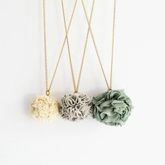Pom pom necklaces made with recycled t-shirts.