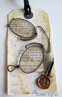 Tag Tuesday Challenge 'Found Objects' by Velvet Moth Studio (antique spectacles, pen nib, feather and sealing wax)
