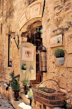Little French shops tucked in stone walls ~ Les Baux de Provence - #Tuscan #Home #Design - Find More Decor Ideas at: http://www.IrvineHomeBlog.com/HomeDecor/ ༺༺ ℭƘ ༻༻ and Pinterest Boards - Christina Khandan - Irvine, California
