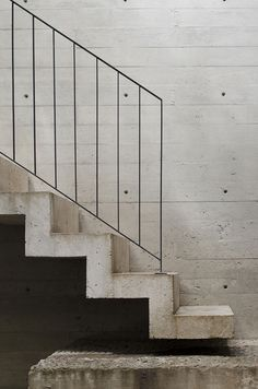concrete stairs + slim metal rail