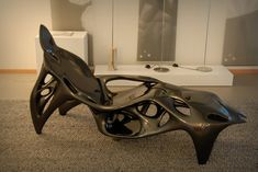 """The Root Chair by Sulan Kolatan and William MacDonald is the largest 3D printed (built on a Materialise Mammoth stereolithography machine) item of furniture made in one single piece. It represents a large family of related chair forms rather than a single design since each chair is digitally """"grown"""" within variable parameters."""