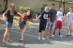 Hula Hoop game -- This game is easy, classic, and fun! Even up teams. One hula hoop per team. Each team stands in a line, holding hands. The goal is to be the first team to get the hula hoop from one end to the other end without braking the link.