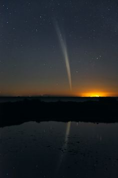 Comet Lovejoy was a sight to behold from Earths Southern Hemisphere in late 2011. Here the comet is reflected in the water of Mandurah Esturary near Perth on December 21, 2011. Image Credit: Colin Legg.