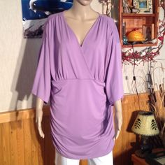 """Luscious Lavender Size 1X Very Flattering 95% Polyester 5% spandex the bust is 48"""". With about 5 more inches for your breasts. Length is 35"""". This would look great with leggings for a casual look or with dress slacks. Pictures don't do it justice on my size small mannequin!! No homes, rips, stains or tears. Non smoking home. Tops"""