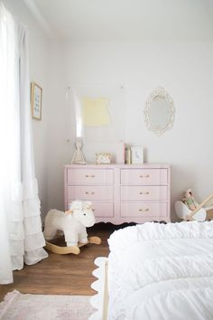 girl bedroom decor, pastel girl bedroom design wiht white bedding and pink dresser and ruffle curtains, neutral girl bedroom decor ideas, diy pastel pink dresser for a girly girl's new big girl room reveal