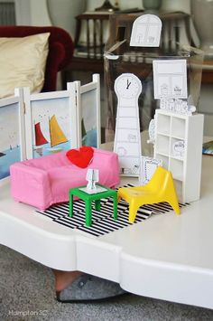 Encourage budding designers to add their own furnishings to their HUSET set.  Bookcase looks like an icecube tray.  The room divider in the back looks like ikea pic frames