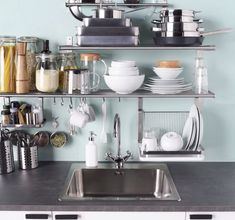 IKEA GRUNDTAL Kitchen Organizing Ideas. This super slim storage hub can easily squeeze onto a tiny kitchen wall without taking up an inch of floor space.   Apartment Therapy