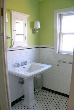 Sink and window in remodeled Mahomet farmhouse bath