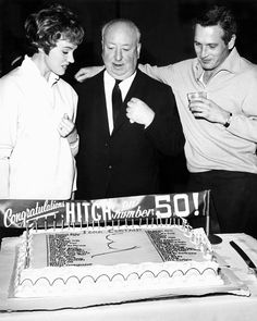 Julie Andrews and Paul Newman celebrate with Alfred Hitchcock the making of his 50th film on the set of Torn Curtain