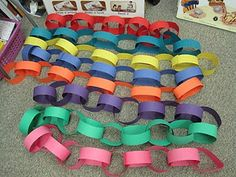 links of 10, then link together until 100th day of school! (Could laminate the paper strips and put velcro on the ends so that they could be reused year after year.)