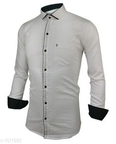 Shirts Fashionable Cotton Solid Shirt  *Fabric* Cotton  *Sleeves* Full Sleeves Are Included  *Size* S, M, L, XL, XXL (Refer Size Chart)  *Length* Refer Size Chart  *Fit* Slim Fit  *Type* Stitched  *Description* It Has 1 Piece of Men's Shirt  *Pattern* Solid  *Sizes Available* XXS, XS, S, M, L, XL, XXL, XXXL, 4XL, 5XL, 6XL, 7XL, 8XL, 9XL, 10XL, Free Size *    Catalog Name: Classico Mens Stylish Cotton Solid Shirts Vol 1 CatalogID_121677 C70-SC1206 Code: 494-1011385-
