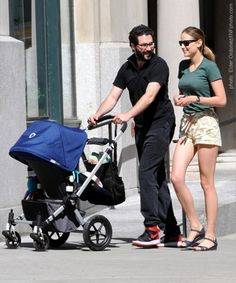 Actress LeeLee Sobieski and fiancè Adam Kimmel bring their daughter, Louisanna Ray Kimmel, out in a fancy four-wheeled #Bugaboo with a bright cover.