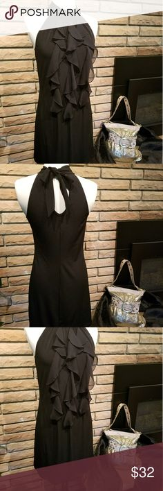 """BCX Small Black Sleeveless Dress with Ruffles BCX small black dress. Sleeveless. Ruffles down the front. Knee length or just above the knee. Ties at the back of the neck. Pre-owned and in good condition. 92% Polyester 8% Spandex. Approximate measurements: Bust  33"""" Waist 29"""" Length 34"""" BCX Dresses Midi"""
