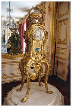 Louis XVs astronomical clock which shows the date (day, month, year), time, phases of the moon, and movement of the planets. You can watch a short French video about it here: http://youtu.be/L9DSiAILKsI