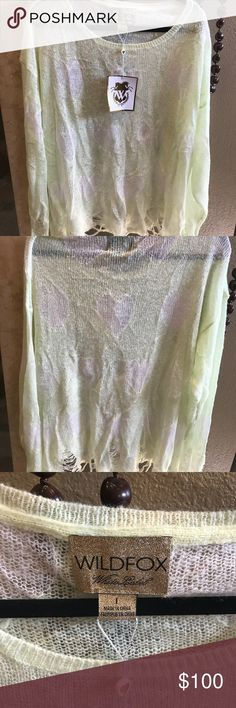 NWT Wildfox sweater L Cute white label Wildfox distressed sweater.  It is a light green/yellow with white hearts.  It is perfect for a pair of shorts in summer or jeans in winter.  It runs big, like a slouchy sweater. Wildfox Sweaters Crew & Scoop Necks