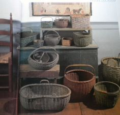 Grouping of primitive painted baskets. Love the whitewashed square on the upper right.