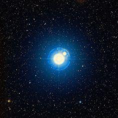Zubenelgenubi looks like one star to the eye, but it's actually two stars.   Image via AAO/STScI/WikiSky
