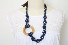 Fabric Statement Necklace, Chomping, Nursing, Teething Necklace -  Navy Dots with Wood Ring. $20.00, via Etsy.