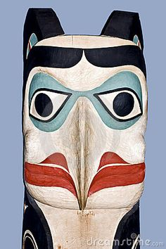 An old traditional Native American carved totam eagle