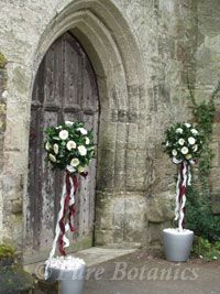 Flowers outside church for a wedding