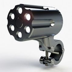 Deter would-be thieves from pinching your bike light by fooling them into thinking it's actually a bicycle Gatling gun, with The Defender, a C'bridge-designed, waterproof aluminum lamp that looks like a revolver cylinder, rocks six ultrabright LEDs (one for each chamber!), and locks onto your handlebars with a special security screwdriver, rendering it totally impervious to being stolen by ordinary tools using ordinary tools.