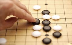 The Japanese game of go actually has its roots in ancient China thousands of years ago; in Chinese it's called weiqi围棋. Instead of employing open confrontation like normal Chinese chess(象棋), weiqi or go stresses finesse and strategy, peaceful coexistence instead of outright conquest.