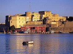 ITALY: Brindisi. After a very hairy train ride from Rome (guys fighting in the carriage, brandishing knives, but no one hurt) - the ferry to Greece. (Photo: Brindisi Castle and Ferry Port.)
