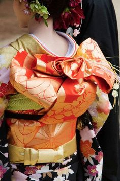Dressing in the traditional kimono requires two people: a friend to tie the elaborate obi is a must.