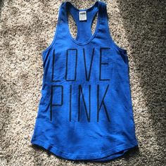 Blue Victoria Secret Love Pink razor back tank top Worn once, cute for the summer, perfect condition, came in a pack with leggings as a sleepwear shirt (but it works just as good as a regular shirt id say) so i dont know how much it costs i just know the whole pack was $65 so im estimating the original cost then. Victoria's Secret Tops Tank Tops
