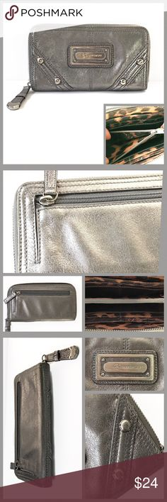 "B MAKOWSKY Soft Leather Zip Around Wallet/Clutch.. B MAKOWSKY-Gorgeous soft leather zip around wallet-APPROX: 8"" x 4.5""-the color is a light  metallic gray-just enough so it is not boring or over the top!!!  Pre-loved a little wear on the exterior. The  interior is pristine!   👉Please see pics for add'l info👆 Thank you, Deb   ❗️no trades ❗️all sales final ❗️please ask questions before purchasing ⭕️ Bootz offers a closet discount on bundling⭕️ B Makowsky Bags Wallets"