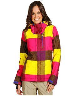 Meritxell is wearing yellow,  pink,  & brown large tartan pattern style on her ski jacket. ^