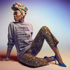 A model with a turban scarf, sweater and pants